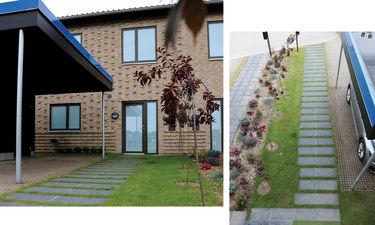nybyggerne terrasse og forhave i det blå hus