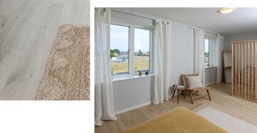 nybyggerne lyse gardiner og naturlige møbler i soveværelset i det grønne hus